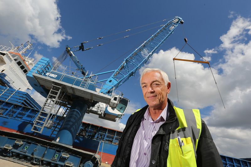 The new Crawler Crane at the Port of Poole with Port Logistics Manager Grant Mowlem.
