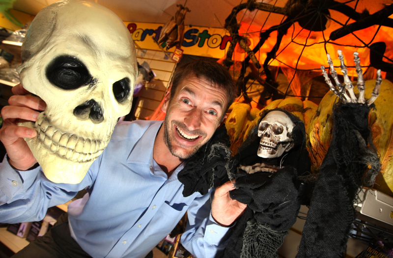 Managing Director Nick Peek with some of the Halloween fancy dress and props at Peeks Party Store in Christchurch.