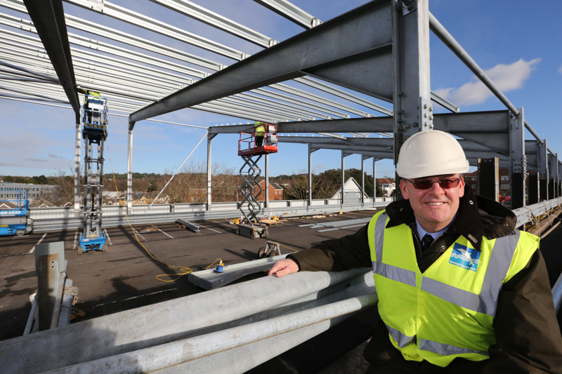 Installation of a solar panel array on the roof of the Borough of Poole staff car park.