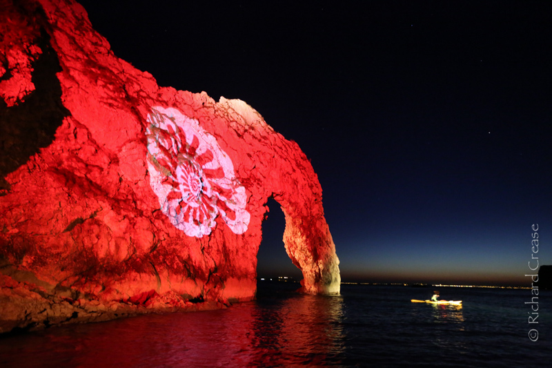 Durdle Door in Dorset illuminated on the Night of Heritage Light .