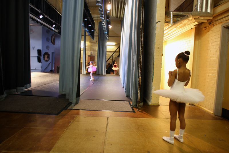 A young dancer waits in the wings to perform at the Bournemouth Music Competition festival.