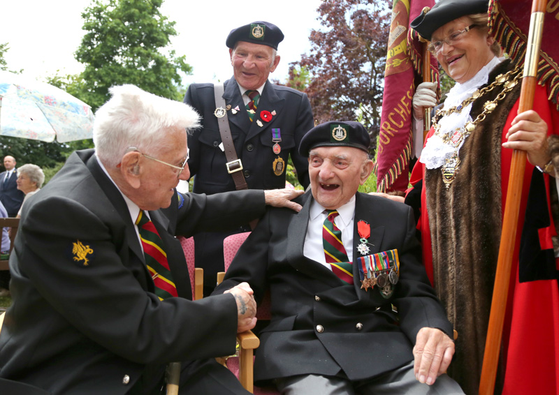 Robert Rigler,98, reminisces with his oldest friend and fellow Dorset Regiment soldier Reg Cossins,94,left, after he received his Legion d'Honneur medal from Mayor of Poole in 2015