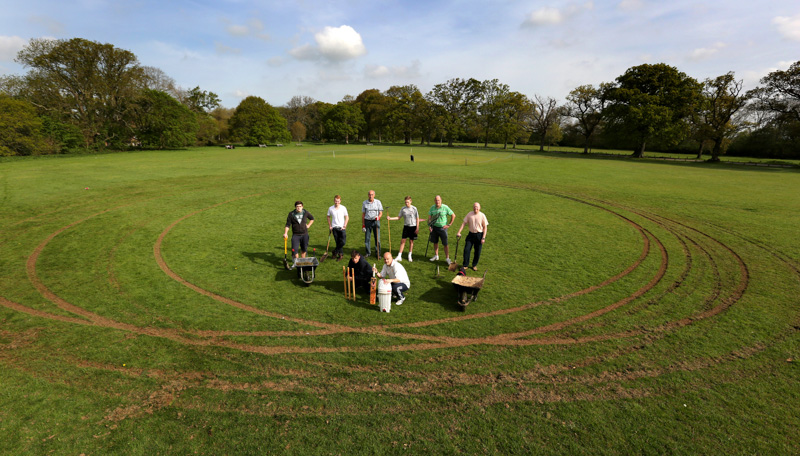 Members of the Kingston Lacy Cricket Team on Pamphill Green after it was damaged by a driver who did 'donuts' all over the pitch.
