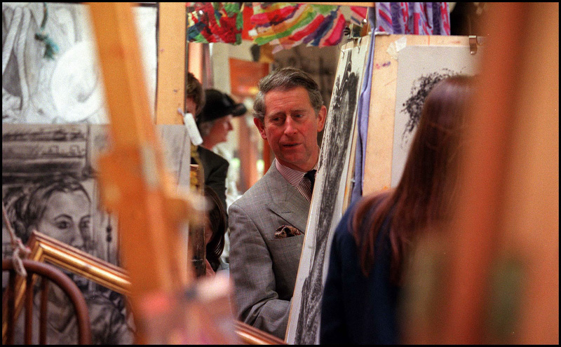 Prince Charles reflects on artwork during a visit to Sherborne School in 1999
