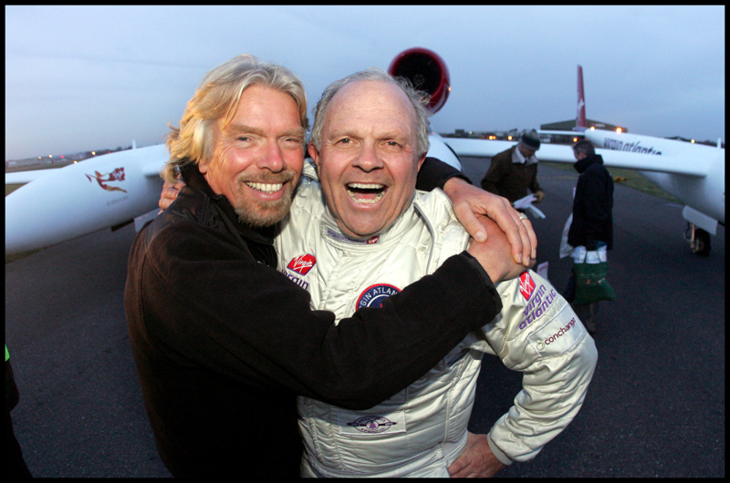Richard Branson greets Steve Fossett after he made an emergency landing at Bournemouth airport having completed the longest manned solo flight around the world in 2006.