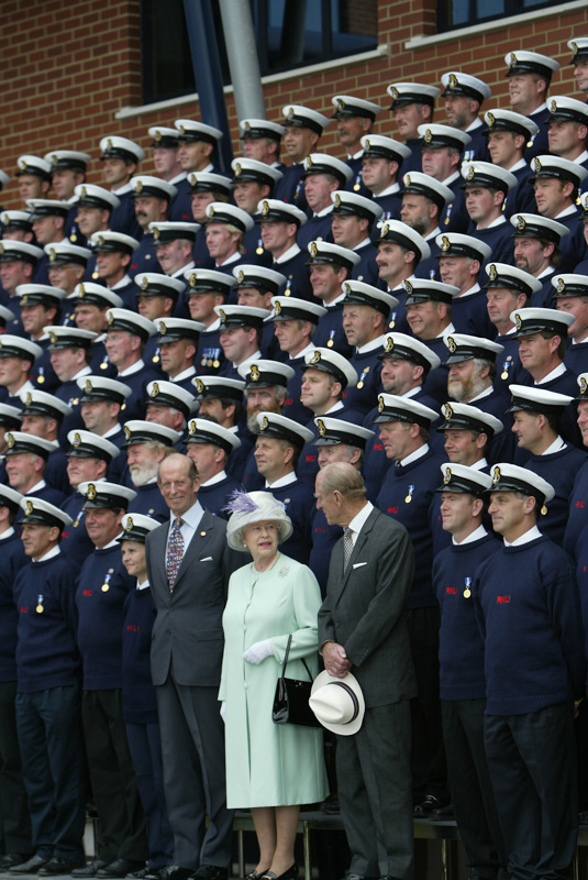 HM The Queen and The Duke of Edinburgh lining up with coxswains from around the country after officially opening new RNLI buildings in Poole. - 2004