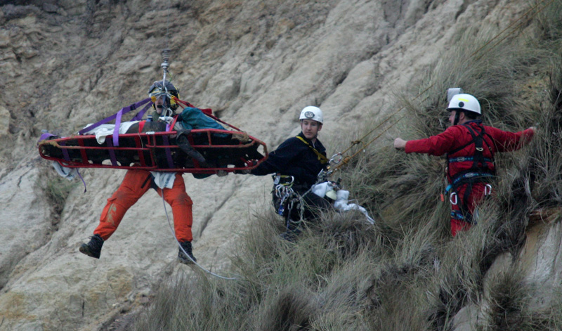 Coastguard team rescue a woman after a cliff fall at Hengistbury Head.