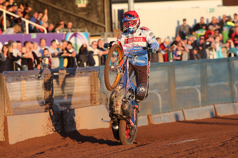 Poole Speedway rider Kacper Gomolski celebrates a heat win
