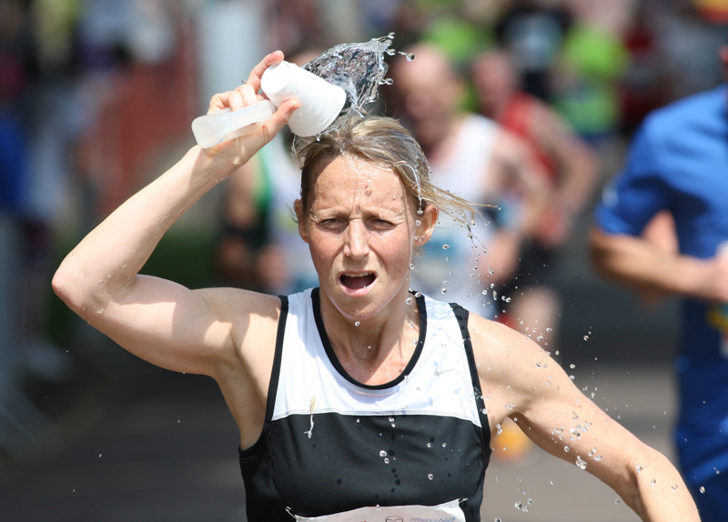 Cooling off in the heat at Poole Festival of Running.