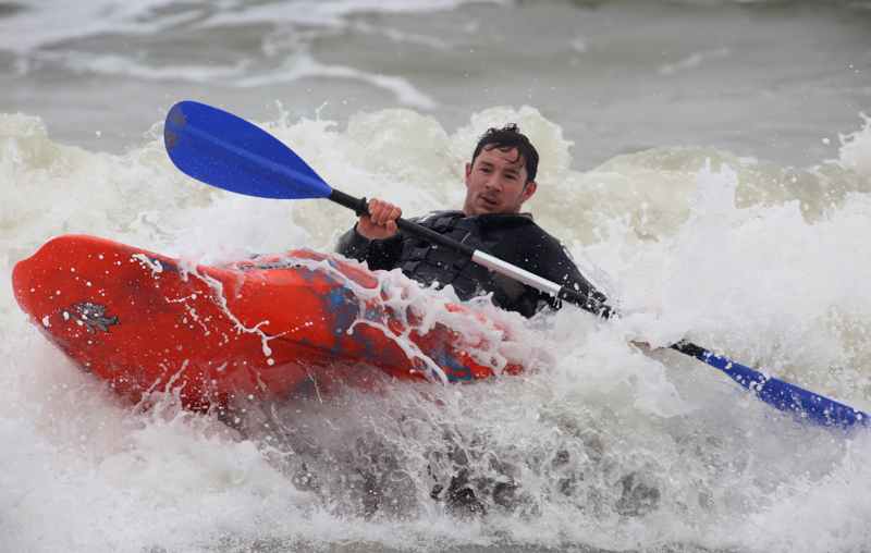 Kayakers enjoy the surf at Boscombe beach