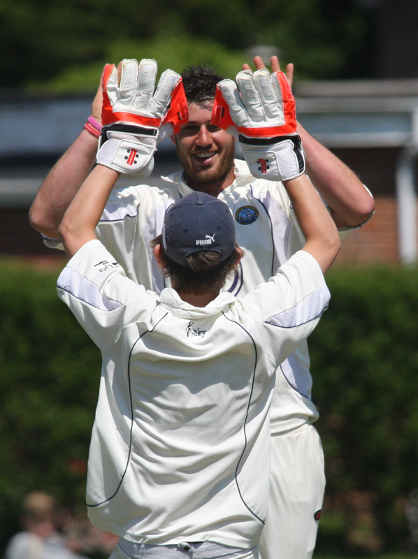Lymington bowler Matt Metcalfe celebrates a wicket against South Wilts.
