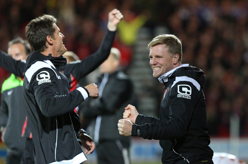 Eddie Howe and Jason Tindall celebrate the goal that secures promotion to the Premier league