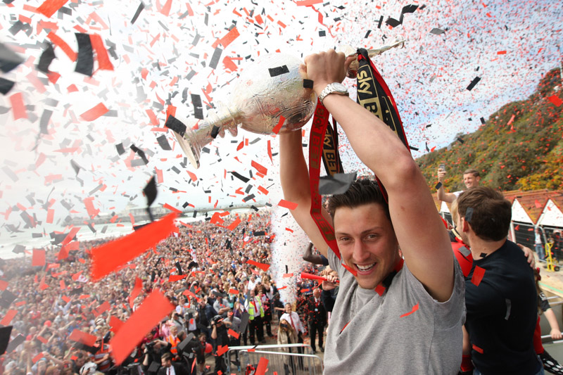 Captain Tommy Elphick lifts the trophy as AFC Bournemouth celebrate promotion to The Premier league in 2015