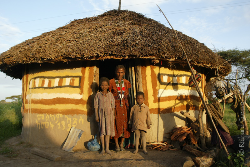 A family outside their home in the Great Rift Valley, Ethiopia.